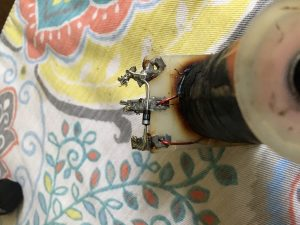 The culprit, one diode, where there should be two. The top lug has actually burned off the wire to the windings.